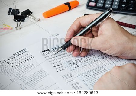 Man Filling Us Tax Form