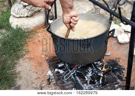 a bowler on the fire on which cook food