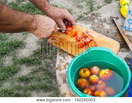 cooking is cut foods hand ripe tomatoes