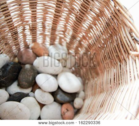 Close up of stones in a wicker Basket
