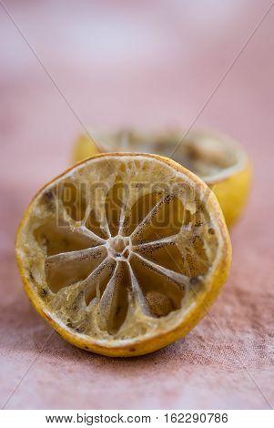 Molded lemon on a wooden background.Molded lemon Macro