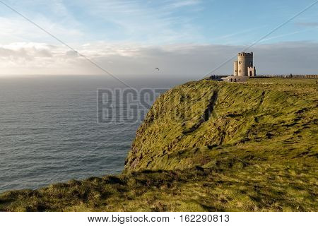 Panoramic shot of a seascape with O'Brien's Tower at the Cliffs of Moher Ireland