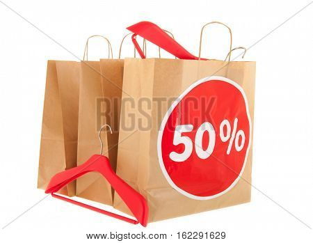 Brown paper shopping bags with 50% discount and  isolated over white background