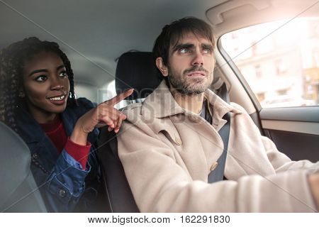 Girl showing the way from the backseat
