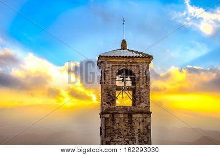 bell tower sunset backlight San Marino colorful sky