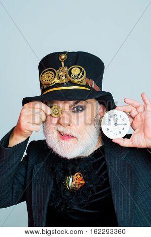 Man Keeps Cogwheel And Clock