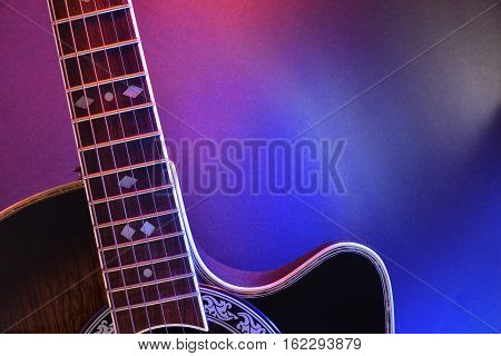 Acoustic Guitar Isolated With Red And Blue Lights