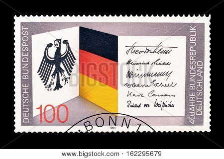 GERMANY - CIRCA 1989 : Cancelled postage stamp printed by Germany, that shows German flag and coat of arms.