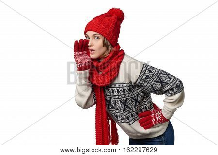 Winter Xmas girl telling a secret with palm shielding mouth, over white background