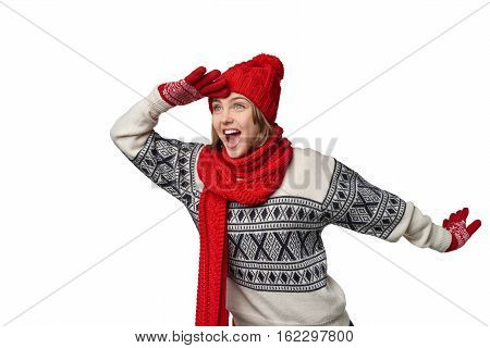 Happy laughing winter woman looking forward with palm on forehead, over white background