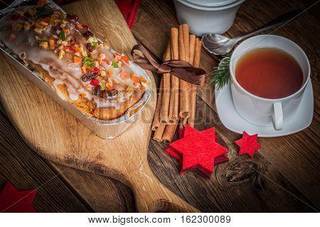 Christmas Homemade Fruitcake On The Wodden Background.