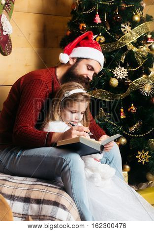 Christmas Bearded Father And Girl Writting