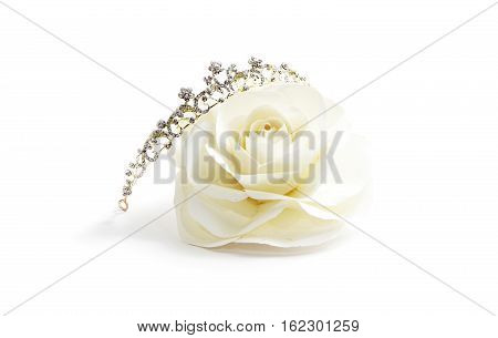 White paper rose princess, Diadem and paper rose on white background