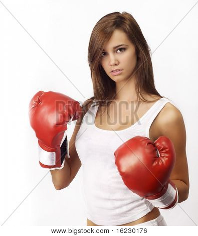 Attractive Caucasian girl practicing boxing, isolated on white background