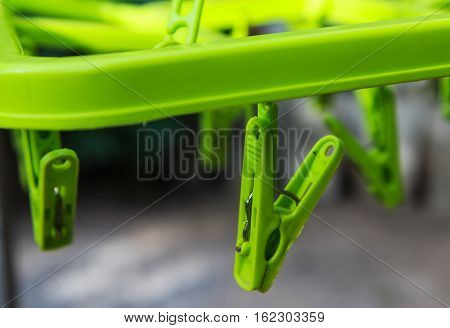 Close up of clothespin green plastic for clothing.