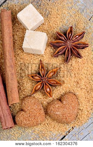 Sugar with anise and cinnamon on wooden table