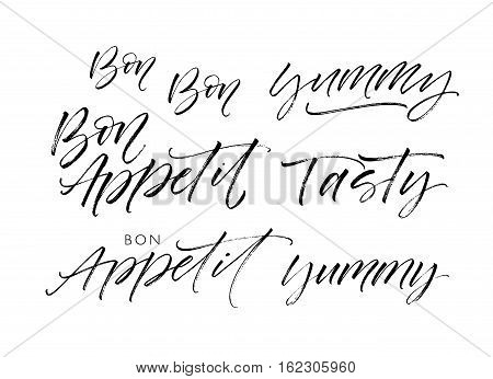 Collection of tasty phrases. Bon appetit tasty yummy. Ink illustration. Modern brush calligraphy. Isolated on white background.