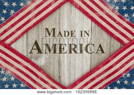 Made in America message USA patriotic old flag on a weathered wood background with text Made in America