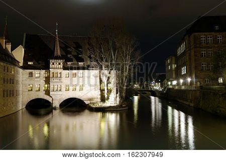 NUREMBERG GERMANY - DECEMBER 02 2015: Hospice of the Holy Spirit at night one of the main landmarks of Nuremberg Germany