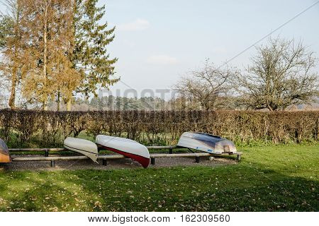 Boats On A Row On Land