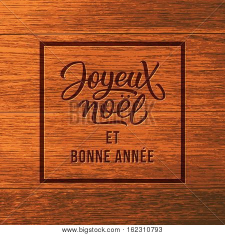 Joyeux Noel typographic text on wooden background. Merry Christmas and Happy New Year french lettering on greeting card vector design template