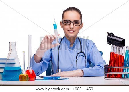 Young doctor with syringe isolated on white