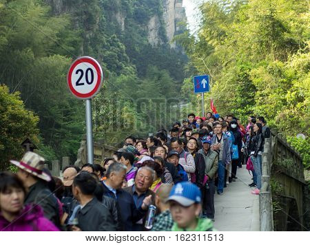 April 14 2015. A long line of tourists queue up to enter the Zhangjiajie National Forest Park. Wulingyuan Zhangjiajie China.