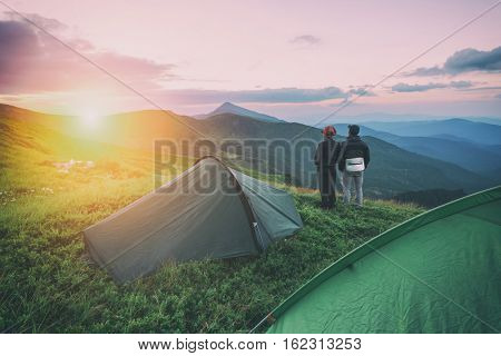 couple near tent on mountains closeup, toned like Instagram filter