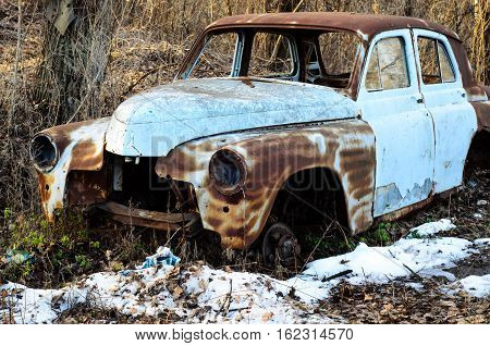 Old rusty car body on a ground