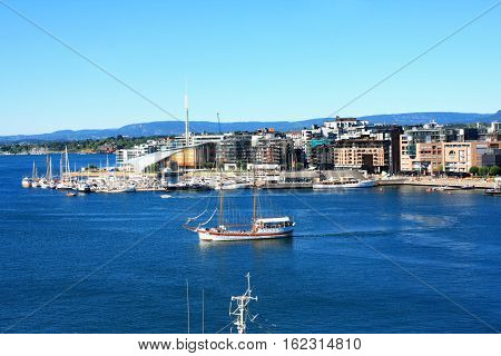 View on modern district Stranden Aker Brygge district with lux apartments and restaurants in Oslo Norway