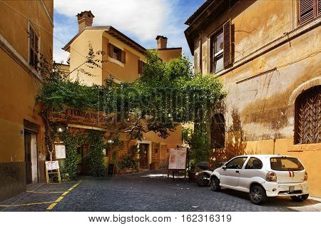 Rome Italy - May 27 2016: Traditional italian food and outdoor restaurant in Trastevere district in Rome Italy.