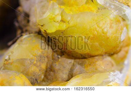 A Tuff yelow mineral, limonite and malachite close up