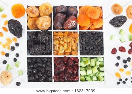 Colorful mix of dried fruit, raisins, apricots, figs, prunes, goji, cranberries, blueberries, prunes, top view