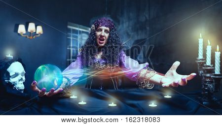 Crazy sorceress practising witchcraft