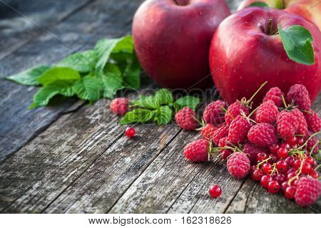 Concept Of Red Berries And Fruits On Wooden Board