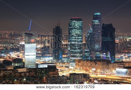 View from the rooftops in the winter on skyscrapers night city Moscow.