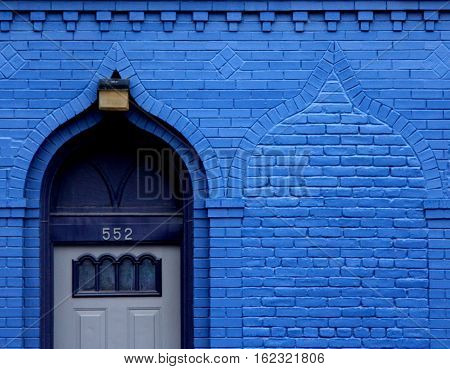 a bright blue doorway has a hidden twin