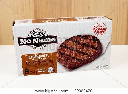 RIVER FALLS,WISCONSIN-DECEMBER 19,2016: A box of No Name brand beef steak burgers with a wood background.