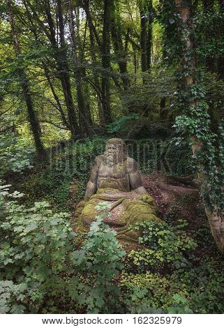Landgraaf, Netherlands - July 12 2016: Statue of Zeus in the folies forest of Parc Mondo Verde.