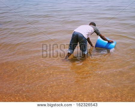 Congolese draws water on Tanganyika lake in Kalemie