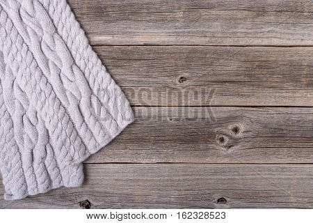 Winter scarf on the background of the old wooden boards.
