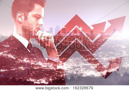 Businessman with chart arrows on red city background. Finance concept Double exposure