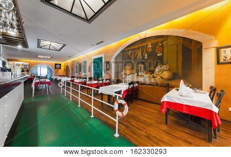 "MOSCOW - JULY 2014: Interior of the international chain fish restaurant ""Porto Maltese"". View of the hall with tables"