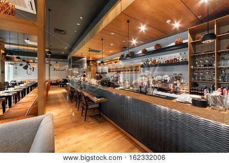 "MOSCOW - AUGUST 2014: Interior of a Japanese restaurant bar and lounge ""KABUKI"". Large modern open kitchen in the main hall"
