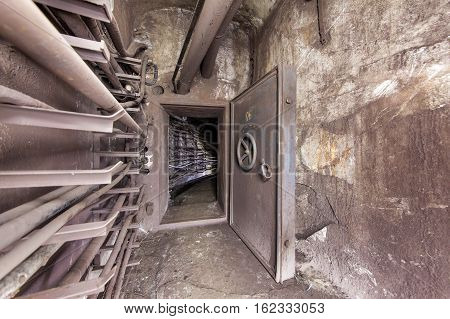Old reinforced security door in an underground communication tunnel