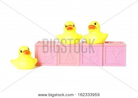 Isolated baby blocks spelling baby with rubber ducks.