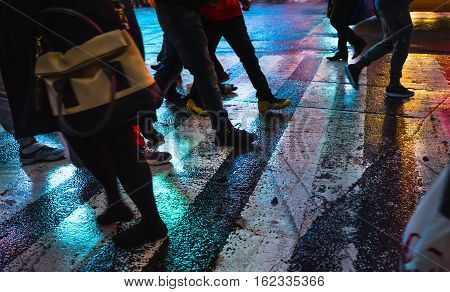Abstract Blurred Image Of Nyc Streets After Rain With Reflections On Wet Asphalt.