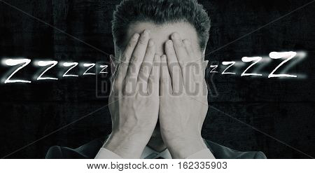 Portrait of man covering face with hands on dark background. Sleep concept