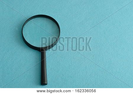 Magnifying glass isolated on a blue background