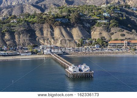 Malibu, California, USA - December 17, 2016:  Afternoon aerial view Malibu Pier and Pacific Coast Highway in Southern California.